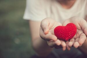 Giving-Tuesday-Woman-Holding-Heart