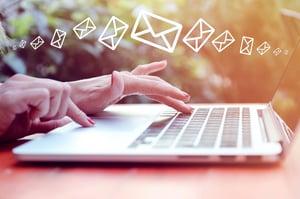 Woman-Sending-Email-Marketing-Messages-Laptop